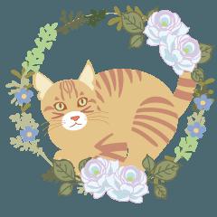 花のリースと猫